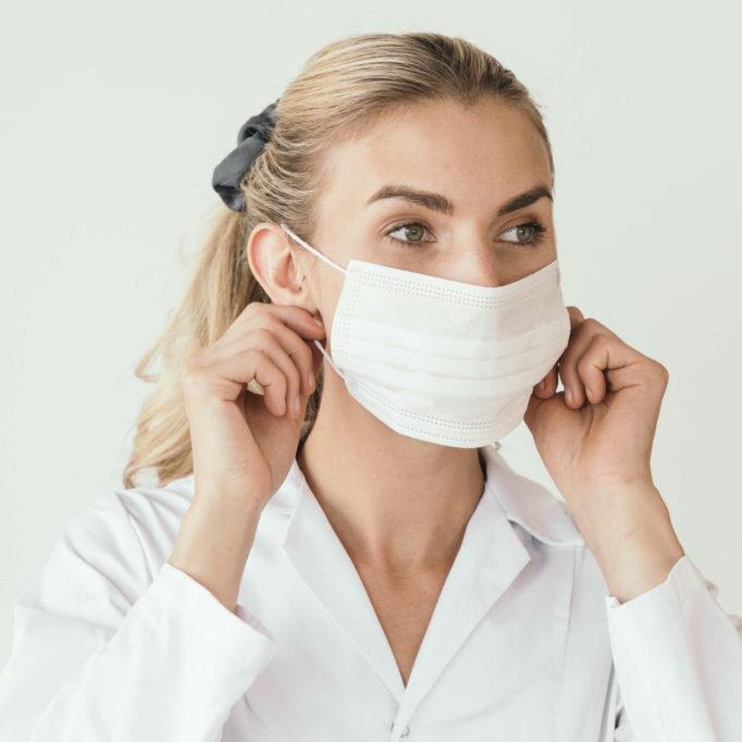 Female doctor or nurse wearing a mouth mask, coronavirus COVID-19 epidemic themed